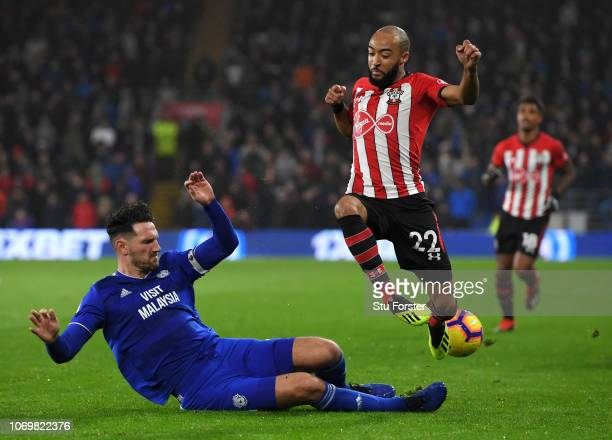 Sean Morrison of Cardiff City tackles Nathan Redmond of Southampton during the Premier League match between Cardiff City and Southampton FC at...
