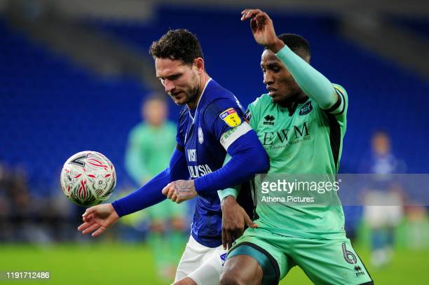 Sean Morrison of Cardiff City vies for possession with Aaron Hayden of Carlisle United during the FA Cup third round match between Cardiff City and...