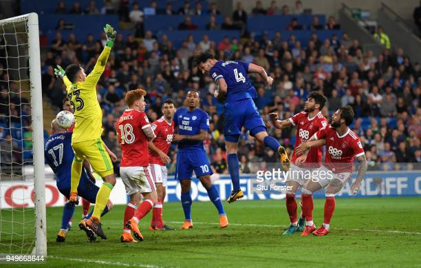 Sean Morrison of Cardiff heads the opening goal during the Sky Bet Championship match between Cardiff City and Nottingham Forest at Cardiff City...
