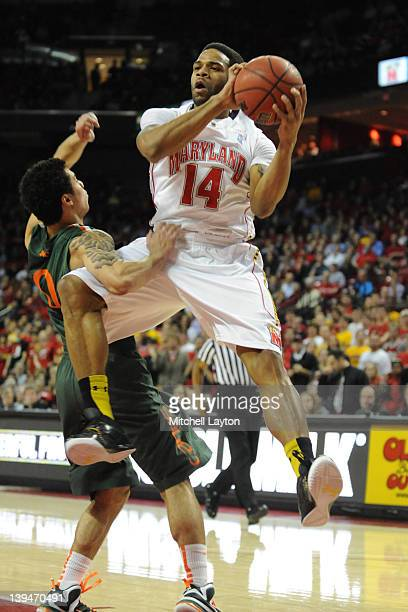 Sean Mosley of the Maryland Terrapins drives to the basket during a college basketball game against Shane Larkin of the Miami Hurricanes on February...