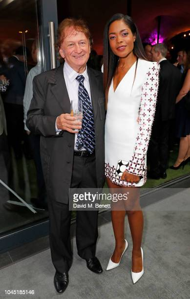 Sean Mulryan and Naomie Harris attend the unveiling of new Guggi sculpture at Embassy Gardens hosted by Ballymore and Harper's Bazaar as part of...