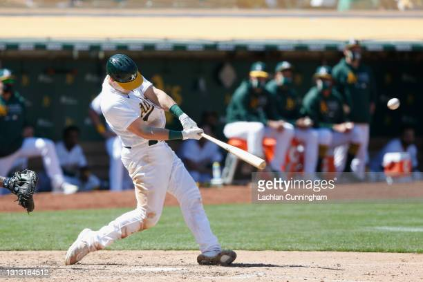 Sean Murphy of the Oakland Athletics hits a solo home run in the bottom of the eighth inning against the Detroit Tigers at RingCentral Coliseum on...