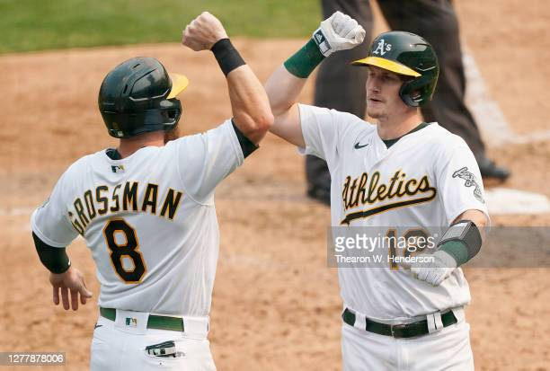 Sean Murphy of the Oakland Athletics is congratulated by Robbie Grossman after Murphy hit a two-run home run against the Chicago White Sox during the...