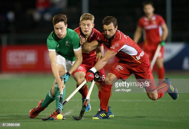 Sean Murray of Ireland and Sebastien Dockier of Belgium battle for possession during day 2 of the FIH Hockey World League Semi Finals Pool B match...