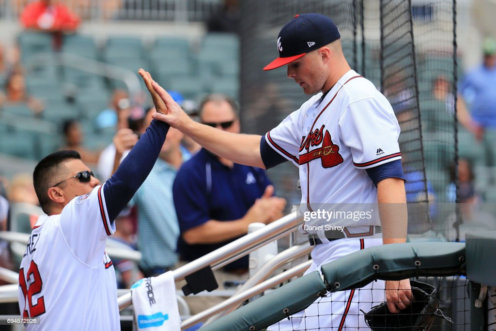 Sean Newcomb #51 of the Atlanta Braves celebrates with first base coach Eddie Perez #12 after coming out in the seventh inning against the New York Mets at SunTrust Park on June 10, 2017 in Atlanta, Georgia.