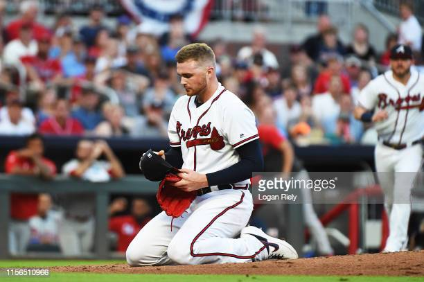 Sean Newcomb of the Atlanta Braves gets hit by the ball in the head against the Philadelphia Phillies at SunTrust Park on June 15, 2019 in Atlanta,...