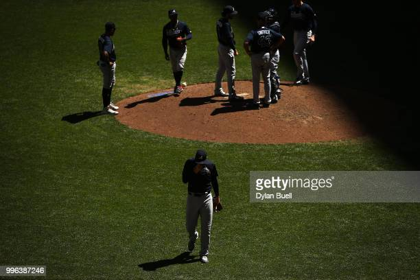 Sean Newcomb of the Atlanta Braves walks off the field after being relieved in the fourth inning against the Milwaukee Brewers at Miller Park on July...