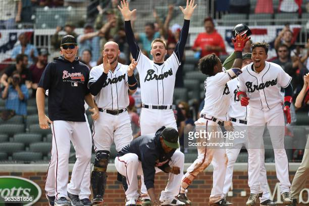 Sean Newcomb Tyler Flowers Freddie Freeman Ozzie Albies and Johan Camargo of the Atlanta Braves wait at home plate for Charlie Culberson after he hit...