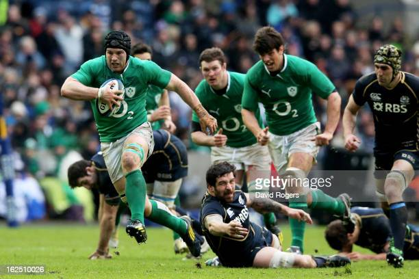 Sean O'Brien of Ireland breaks through the tackle from Jim Hamilton of Scotland during the RBS Six Nations match between Scotland and Ireland at...