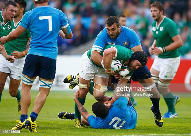 Sean O'Brien of Ireland is tackled by Andrea Manici and Quintin Geldenhuys of Italy during the 2015 Rugby World Cup Pool D match between Ireland and...