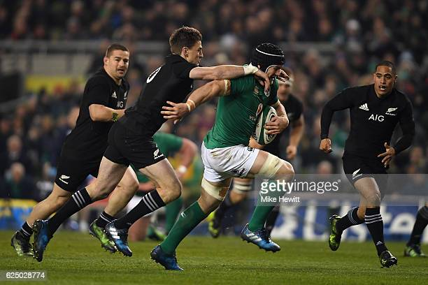 Sean O'Brien of Ireland is tackled by Beauden Barrett of New Zealand during the International Friendly between Ireland and New Zealand at Aviva...