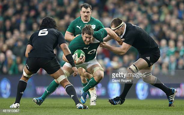 Sean O'Brien of Ireland is tackled by Brodie Retallick during the International match between Ireland and New Zealand All Blacks at the Aviva Stadium...