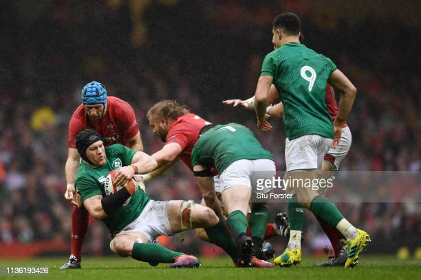 Sean O'Brien of Ireland is tackled by Justin Tipuric of Wales during the Guinness Six Nations match between Wales and Ireland at Principality Stadium...