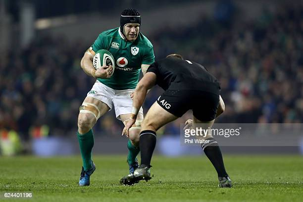 Sean O'Brien of Ireland is tackled during the international rugby match between Ireland and the New Zealand All Blacks at Aviva Stadium on November...