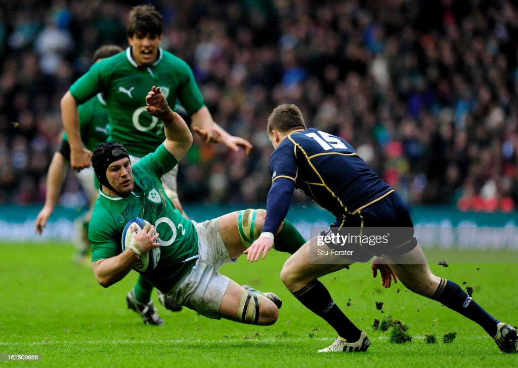 Sean O'Brien of Ireland loses his footing as he is challenged by Stuart Hogg of Scotland during the RBS Six Nations match between Scotland and Ireland at Murrayfield Stadium on February 24, 2013 in Edinburgh, Scotland.