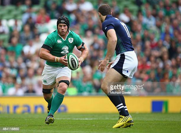 Sean O'Brien of Ireland runs at Tim Visser of Scotland during the International match between Ireland and Scotland at the Aviva Stadium on August 15...