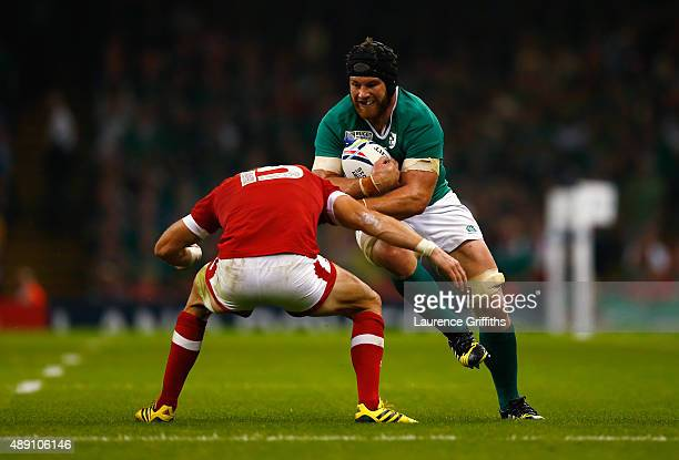 Sean O'Brien of Ireland takes on Matt Evans of Canada during the 2015 Rugby World Cup Pool D match between Ireland and Canada at the Millennium...
