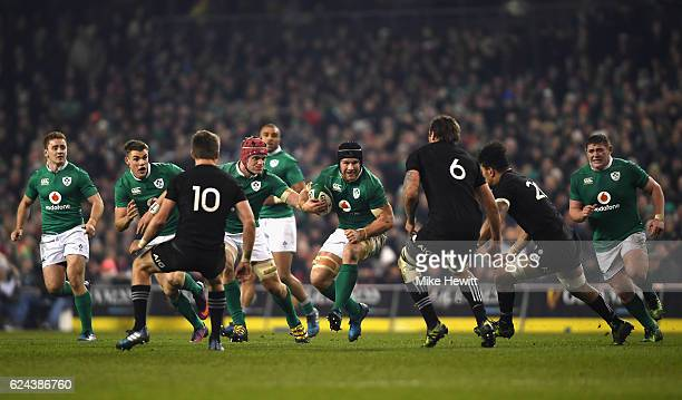Sean O'Brien of Ireland takes on the New Zealand defence during the International match between Ireland and New Zealand All Blacks at Aviva Stadium...
