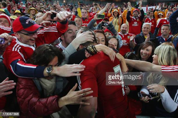 Sean O'Brien of the British Irish Lions celebrates with fans after winning the International Test match between the Australian Wallabies and British...