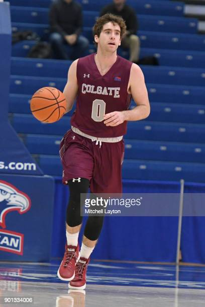 Sean O'Brien of the Colgate Raiders dribbles the ball during a college basketball game against the American University Eagles at Bender Arena on...