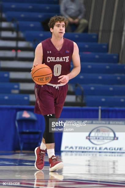 Sean O'Brien of the Colgate Raiders dribbles up court during a college basketball game against the American University Eagles at Bender Arena on...