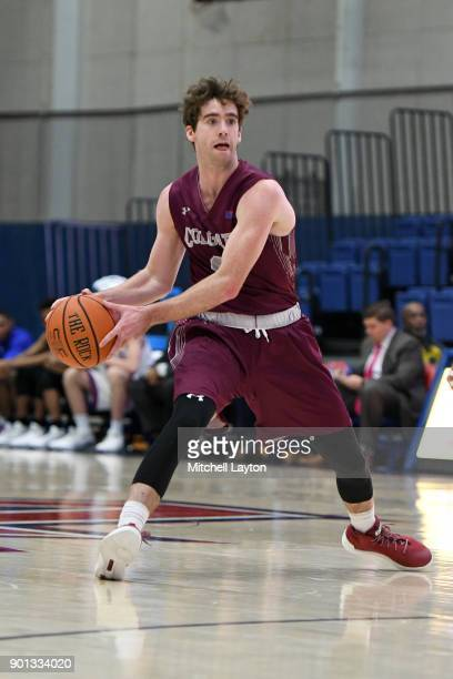 Sean O'Brien of the Colgate Raiders looks to pass the ball during a college basketball game against the American University Eagles at Bender Arena on...