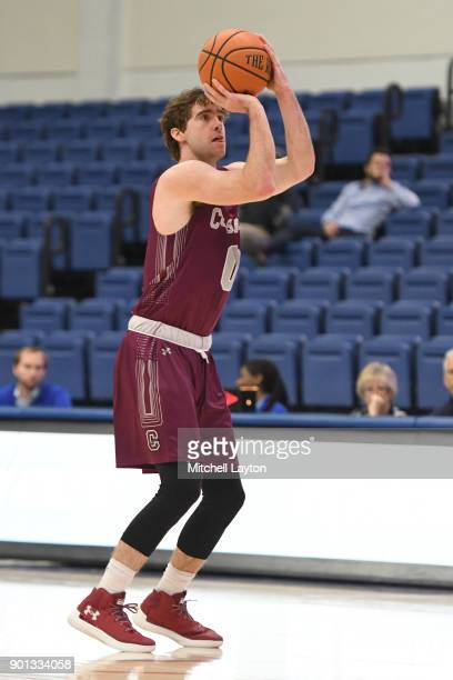 Sean O'Brien of the Colgate Raiders takes a jump shot during a college basketball game against the American University Eagles at Bender Arena on...