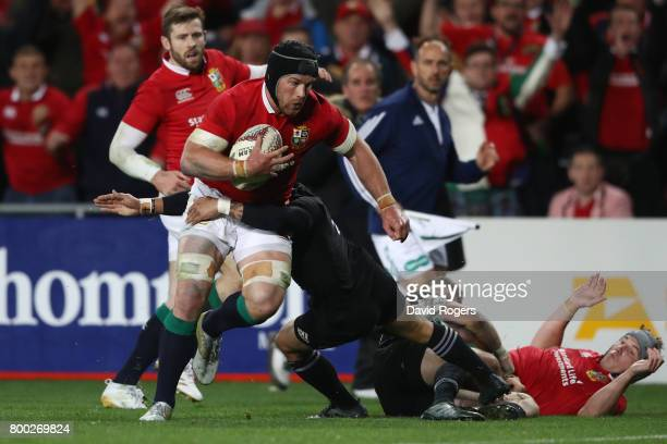 Sean O'Brien of the Lions charges towards the tryline to score his team's first try during the first test match between the New Zealand All Blacks...