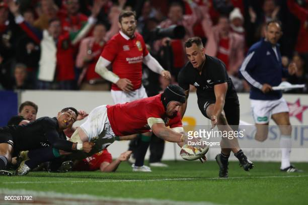Sean O'Brien of the Lions dives over to score his team's first try during the first test match between the New Zealand All Blacks and the British...