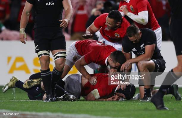 Sean O'Brien of the Lions is congratulated by teammates after scoring his team's first try during the first test match between the New Zealand All...