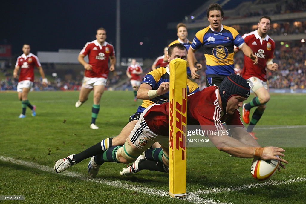 Sean O'Brien of the Lions is tackled into touch during the match between Combined Country and the British & Irish Lions at Hunter Stadium on June 11, 2013 in Newcastle, Australia.