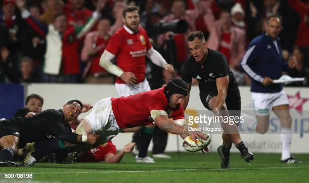 Sean O'Brien of the Lions scores a try during the Test match between the New Zealand All Blacks and the British Irish Lions at Eden Park on June 24...