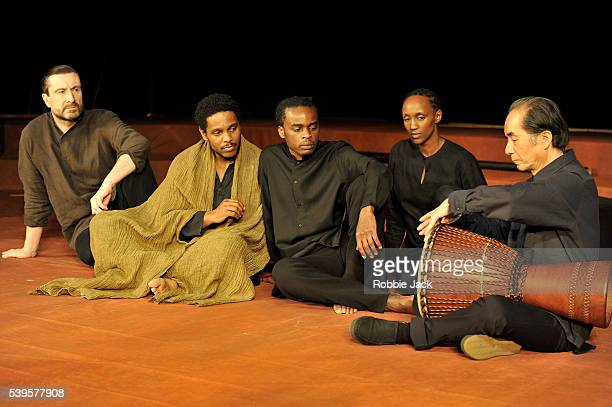 Sean O'Callaghan Jared McNeill Ery Nzaramba Carole Karemera and Toshi Tsuchitori in Theatre des Bouffes du Nord's production of Battlefield wich is...
