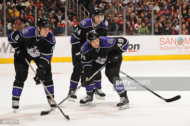 Sean O'Donnell Alexander Frolov and Brandon Segal of the Los Angeles Kings prepare for the faceoff against the Detroit Red Wings on January 7 2010 at...