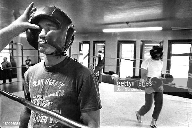 MAR 26 1982 MAR 28 1982 Sean O'Grady endures a thick layer of Vaseline applied to his face prior to a sparing session at the Golden Gloves Gym Friday...