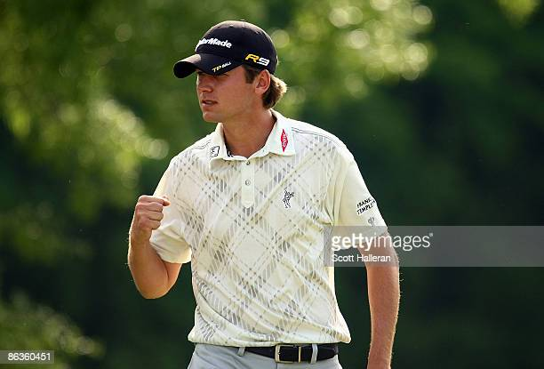Sean O'Hair celebrates a birdie putt on the 16th green during the final round of the Quail Hollow Championship at the Quail Hollow Club on May 3 2009...