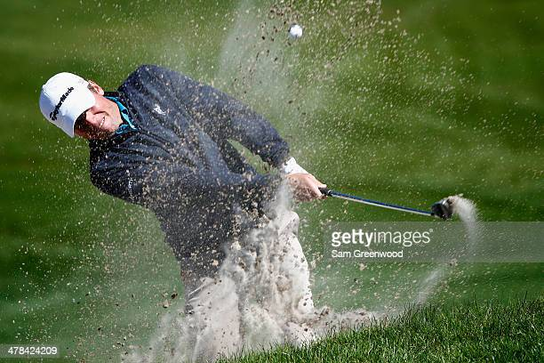 Sean O'Hair hits a shot out of a bunker on the 8th hole during the first round of the Valspar Championship at Innisbrook Resort and Golf Club on...