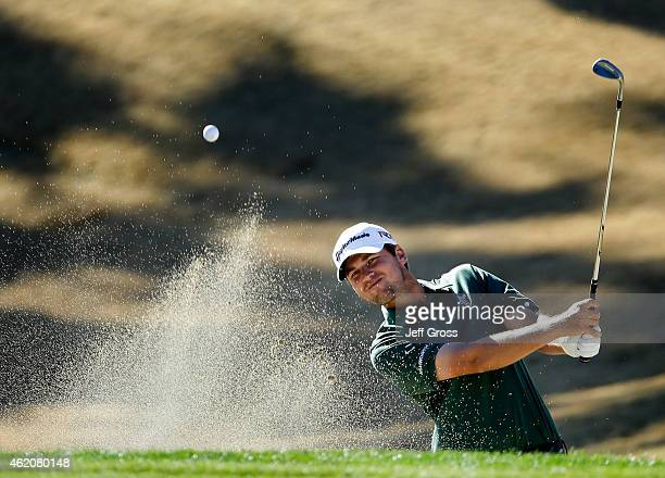 Sean O'Hair of the United States takes his shot out of the bunker on the third hole during round three of the Humana Challenge in Partnership with...