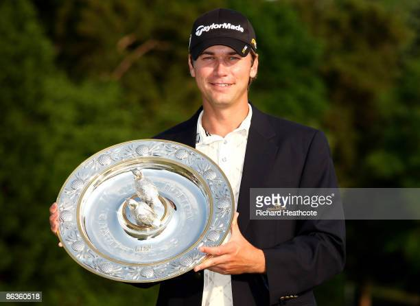 Sean O'Hair of the USA poses with the trophy after his 1 shot victory during the final round of the Quail Hollow Championship at Quail Hollow Golf...