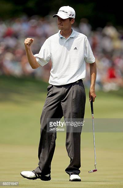 Sean O'Hair pumps his fist after making a par putt to win the John Deere Classic at TPC at Deere Run on July 10 2005 in Silvis Illinois