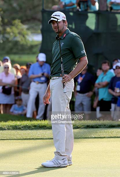 Sean O'Hair reacts after a putt on the third playoff hole during the final round of the Valspar Championship at Innisbrook Resort Copperhead Course...
