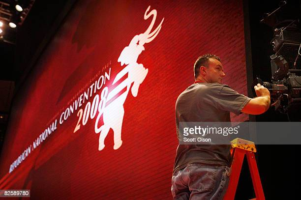 Sean O'Halloran makes adjustments to a remotecontrolled television camera above the stage inside the Xcel Energy Center in preparation for the...