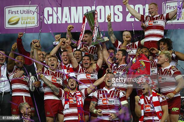 Sean O'Loughlin and Matty Smith of Wigan lift the winners trophy after their sides 126 victory during the First Utility Super League Final between...