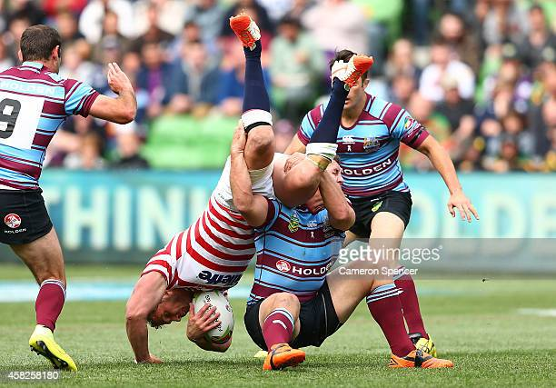 Sean O'Loughlin of England is upended by Greg Bird of Australia during the Four Nations match between the Australian Kangaroos and England at AAMI...