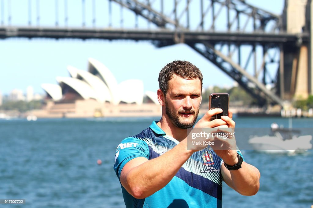 Sean O'Loughlin of the Wigan Warriors takes selfies on a journalist's phone in front of the media during a rugby league international double header media opportunity at Blues Point Reserve on February 13, 2018 in Sydney, Australia.
