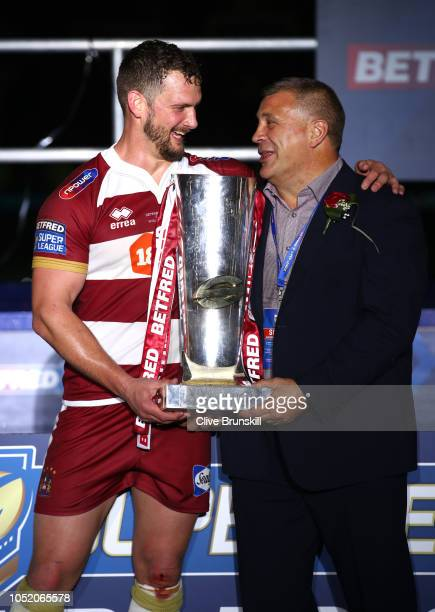 Sean O'Loughlin of Wigan Warriors and Shaun Wane Manager of Wigan Warriors celebrate with the trophy following victory in the BetFred Super League...