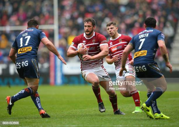 Sean OLoughlin of Wigan Warriors runs at the St Helens defence during the Betfred Super League match between Wigan Warriors and St Helens at DW...