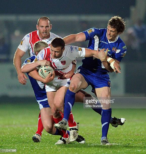 Sean O'Loughlin of Wigan Warriors tackles Rhys Lovegrove of Hull Kingston Rovers during the Engage Super League match between Hull Kingston Rovers...