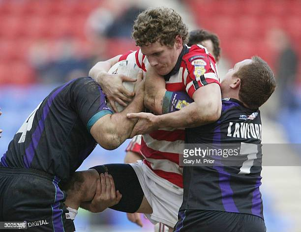 Sean O'Loughlin of Wigan Warriors tries to break through during the Powergen Challenge Cup match between Wigan Warriors and Widnes Vikings at The JJB...
