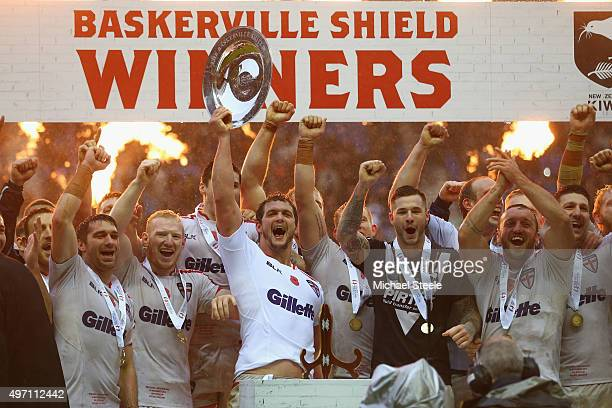 Sean O'Loughlin the captain of England lifts the winners trophy after clinching the series 21 during the third International Rugby League Test Series...